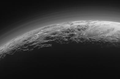 Like Titan, Pluto's environment is hazy, however for a unique motive